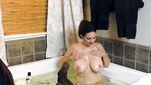 BBW Mindi Mink close up posing in the shower